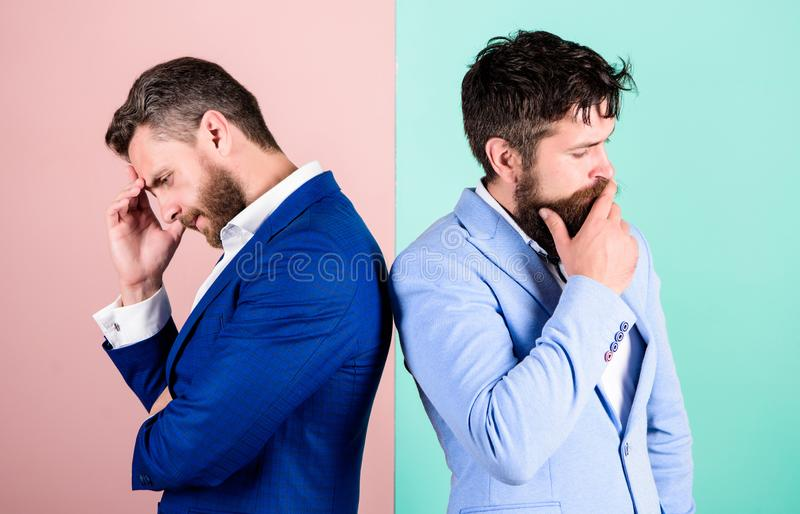 Opinion difference. Businessmen thoughtful face thinking about business problem. Business in trouble concept. Business. Misunderstanding. Business team work on stock image