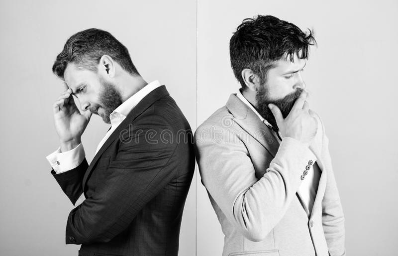 Opinion difference. Businessmen thoughtful face thinking about business problem. Business in trouble concept. Business. Misunderstanding. Business team work on royalty free stock photo