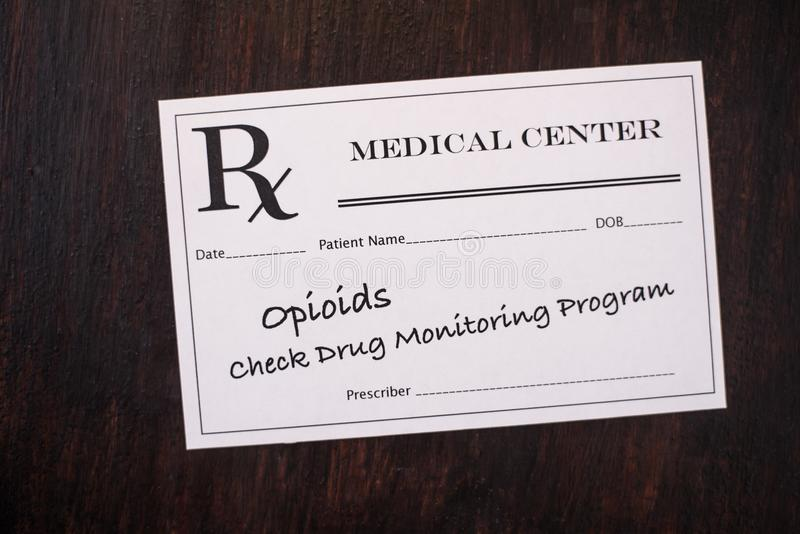 Opioid Prescription - check monitoring program. Opioid prescription with warning to check drug monitoring program stock image