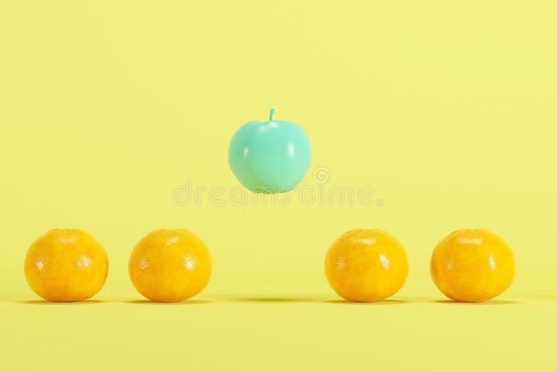 Opmerkelijke blauwe geschilderde appel die onder echte sinaasappelen op pastelkleur gele achtergrond drijven royalty-vrije stock afbeelding
