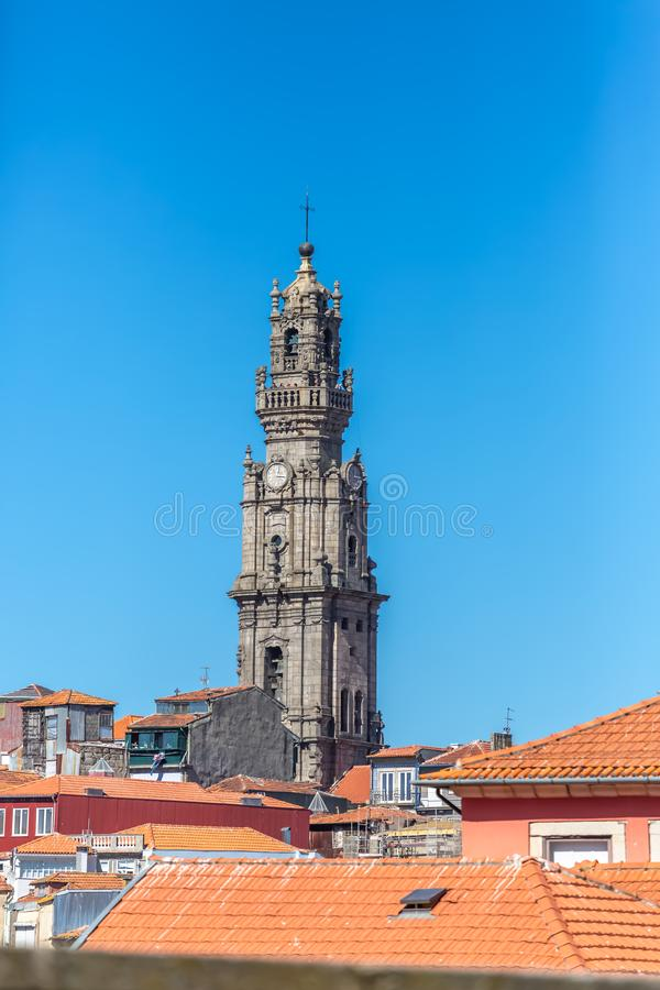 View at the Clerigos tower, baroque icon on Porto city, roof buildings and sky. Oporto/Portugal - 10/02/2018 :View at the Clerigos tower, baroque icon on Porto royalty free stock photography