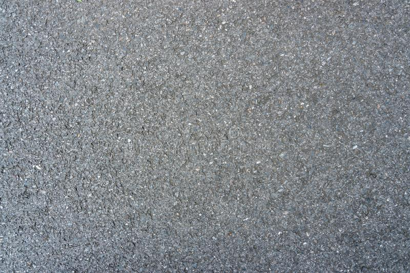 Oppervlakte ruw van zwarte asfalt concrete achtergrond Naadloze grijze weg royalty-vrije stock fotografie