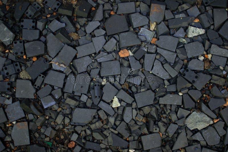 Oppervlakte van de de rotsclose-up van de behangtextuur de zwarte verpletterde stock foto's