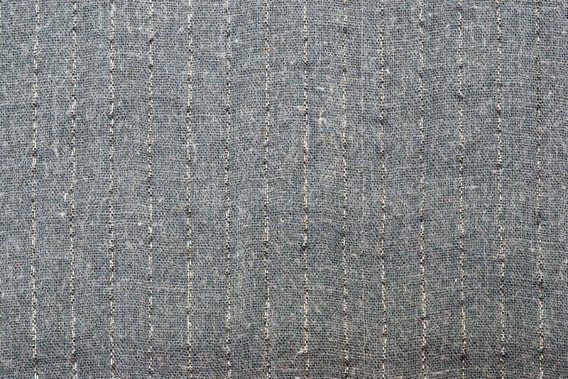 Oppervlakte van grijze gestreepte stof stock afbeelding