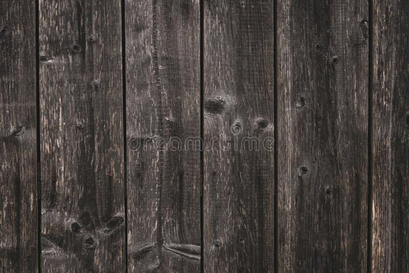 Oppervlakte van ongeraffineerde grijze raad Textuur van het donkere grijze ruwe planking Ruwe houten omheining i Achtergrond o royalty-vrije stock fotografie