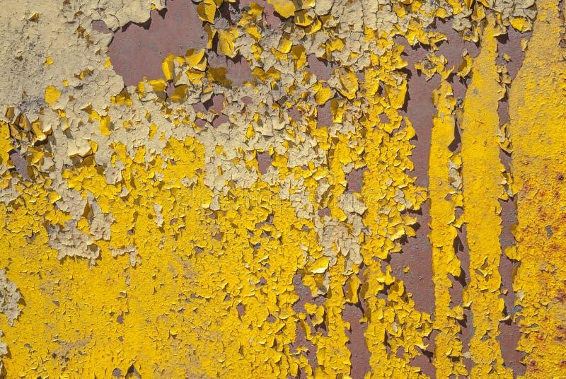 Oppervlakte van roestig ijzer met resten van oude verf, afgebroken verf, textuurachtergrond stock afbeelding