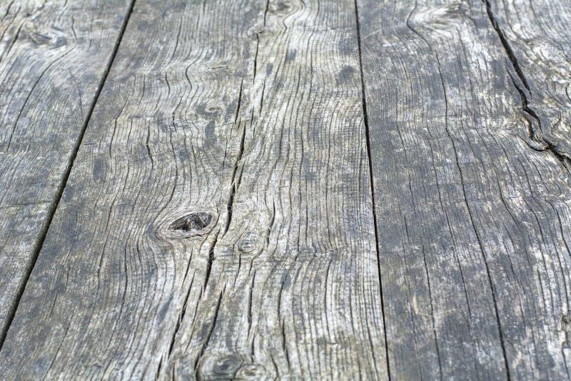 Oppervlakte van zwart-witte houten lijst stock fotografie