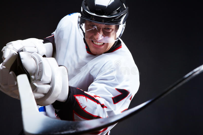 Opponent. Angry ice-hockey player pointing stick into opponent royalty free stock photo