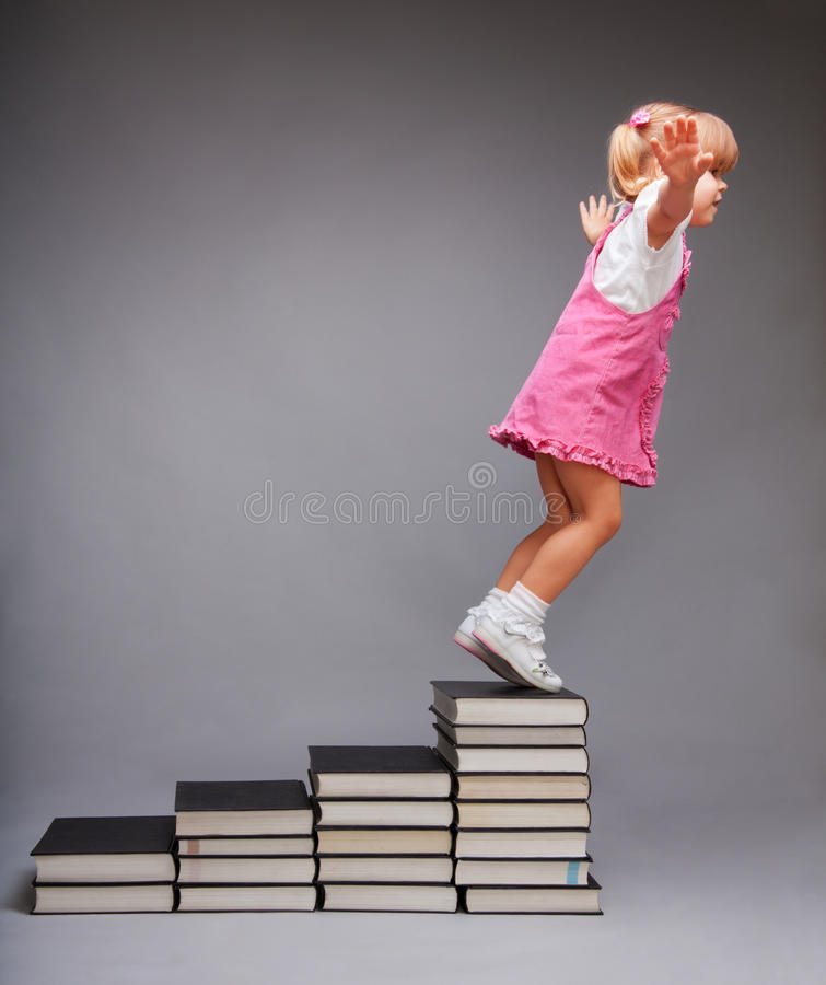 Opportunities after education. Girl jumping from steps that symbolize education stages made of books
