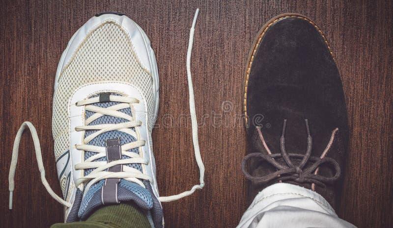 Opposing shoe styles. Two opposing shoe styles on wood stock photos