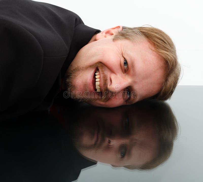 Opposite behavior in mirror. Man showing opposite behavior in mirror: happiness and sadness stock images