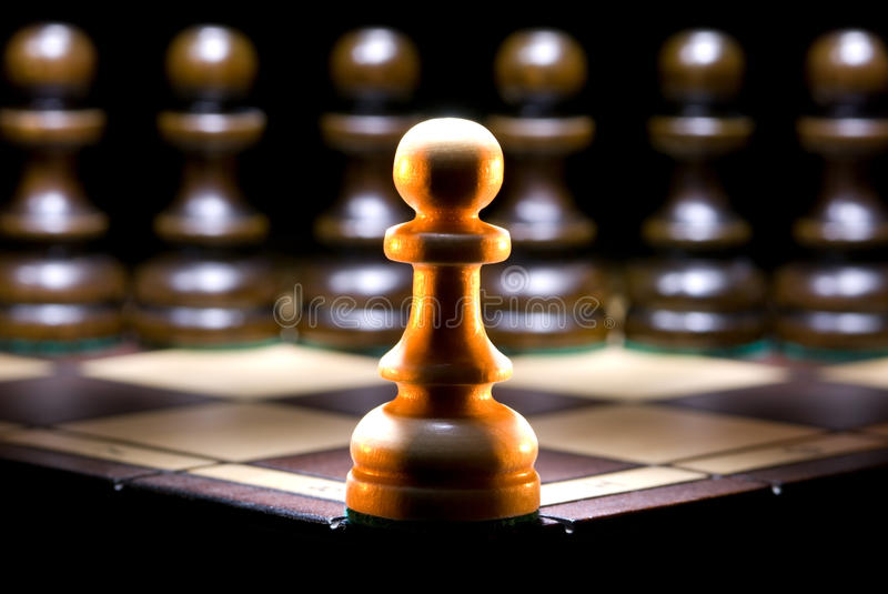 Opposition. It is a lot of chessmen on a chess board. (are located it is horizontal). A black background royalty free stock photo