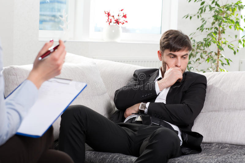 Download Oppressed Businesman Talking With Psychologist Stock Photo - Image: 31427420
