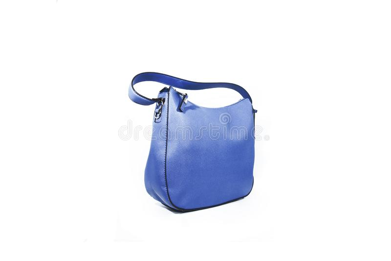 Opróżnia błękitną damy torebkę odizolowywającą na białym tle zdjęcie stock