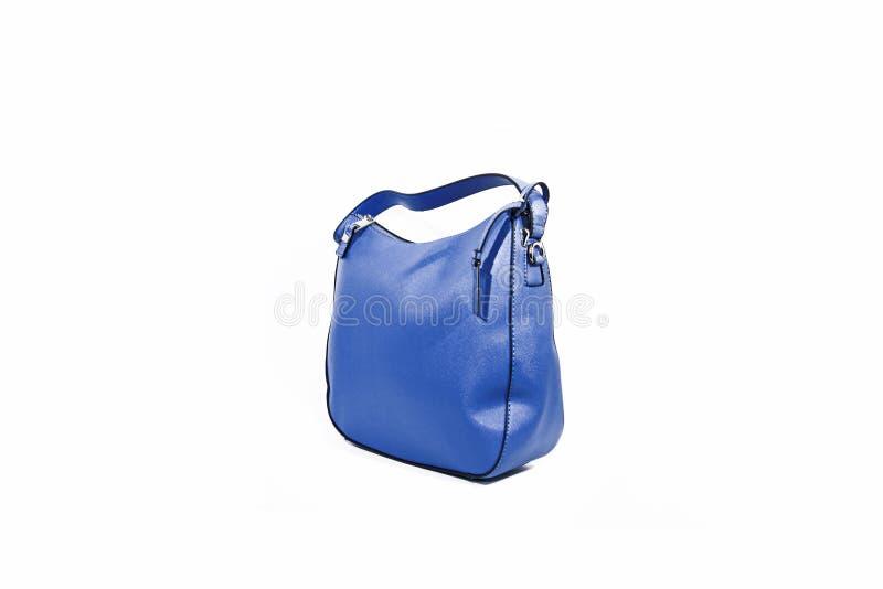 Opróżnia błękitną damy torebkę odizolowywającą na białym tle obraz royalty free