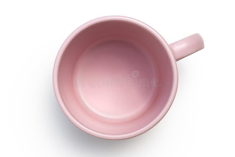 Opróżnia różowego ceramicznego kubek odizolowywającego na bielu z góry fotografia stock