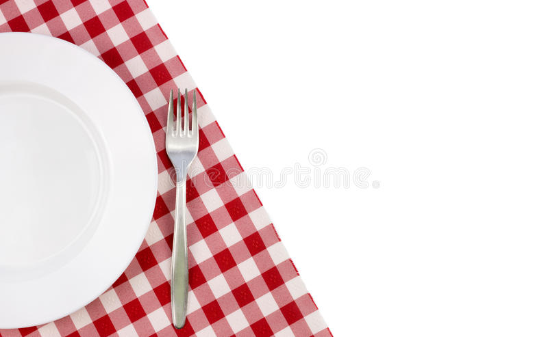 Opróżnia talerza na tablecloth fotografia royalty free