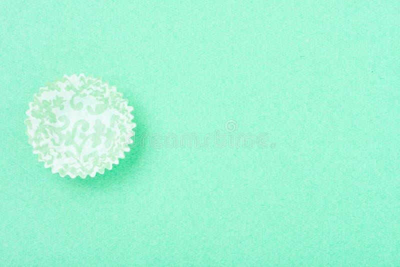 Opróżnia wzorzystego babeczka liniowa na textured tle fotografia stock