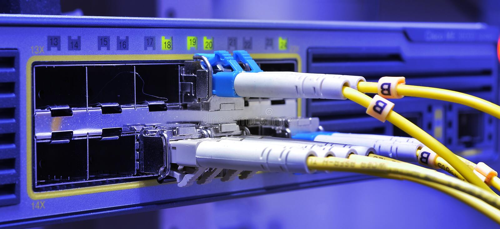 Optic fiber cables connected to data center royalty free stock images
