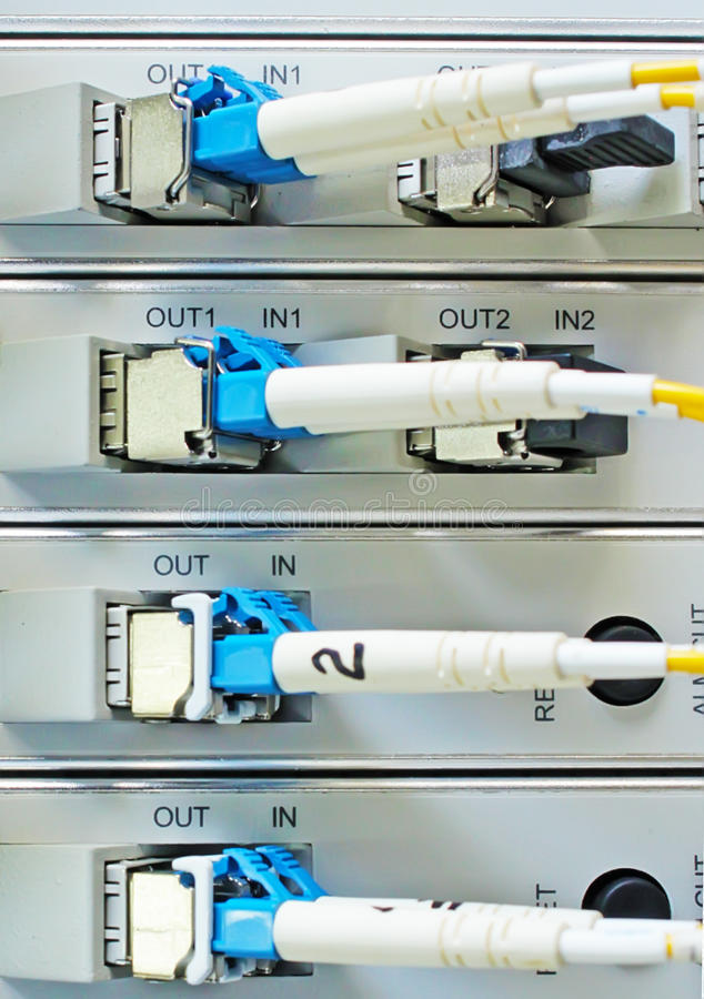 Optic fiber cables connected to data center stock photo