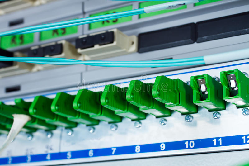 Optic fiber ports. Fieber optic network ports on switch royalty free stock photography