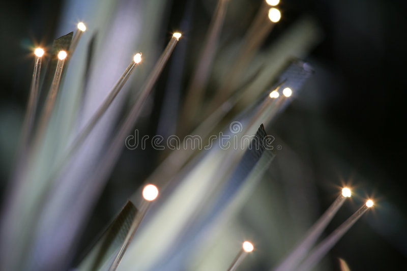 Optic Fibres Light. A background with a closeup view of lighted fibre optic tips used in a Christmas tree stock photography
