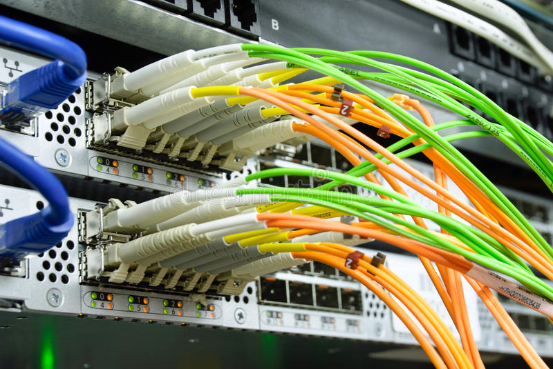 Optical connection. Picture of optical cables pluged in network server