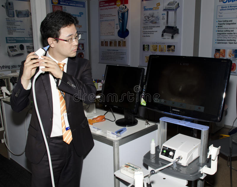 Optical Ear Inspection. Bangkok, Sept 16, 2011, A visitor tests an optical ear probe at Medical Fair Thailand; show casing equipment, products and supplies royalty free stock photo