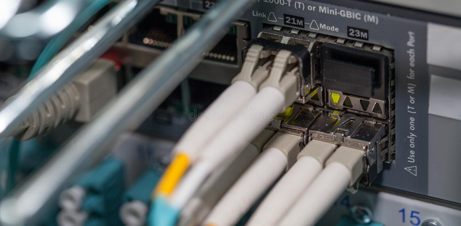 Optical fiber connection on the cloud network port server royalty free stock photography