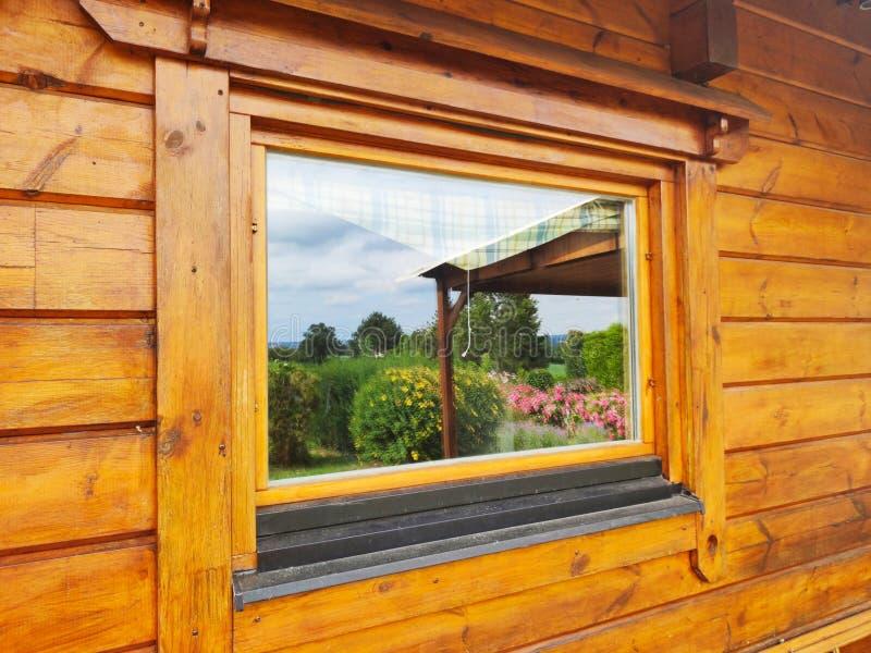 Optical illusion. Woodenhouse, optical, illusion, chalet, window, garden royalty free stock image