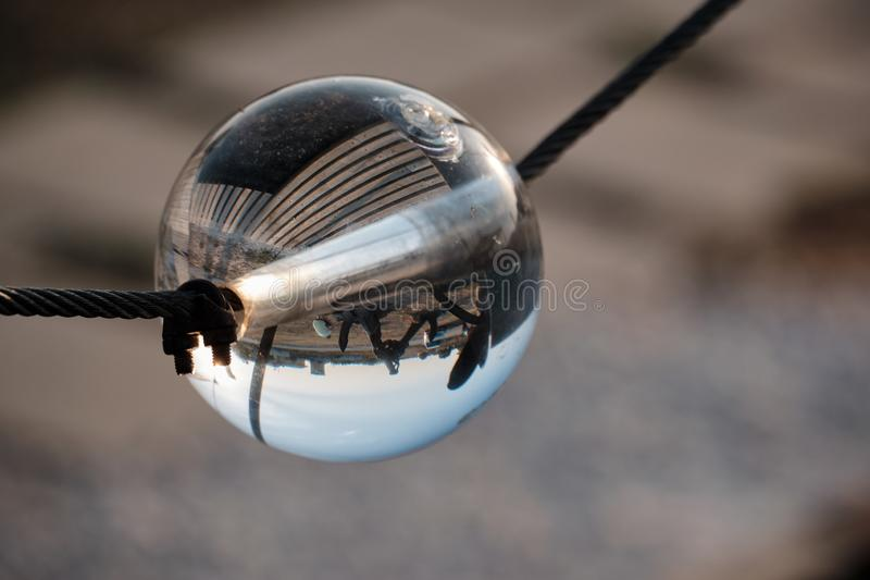 Optical illusions in a crystal sphere. Near Shabla Lighthouse, Bulgaria. You can see the world upside down royalty free stock photo