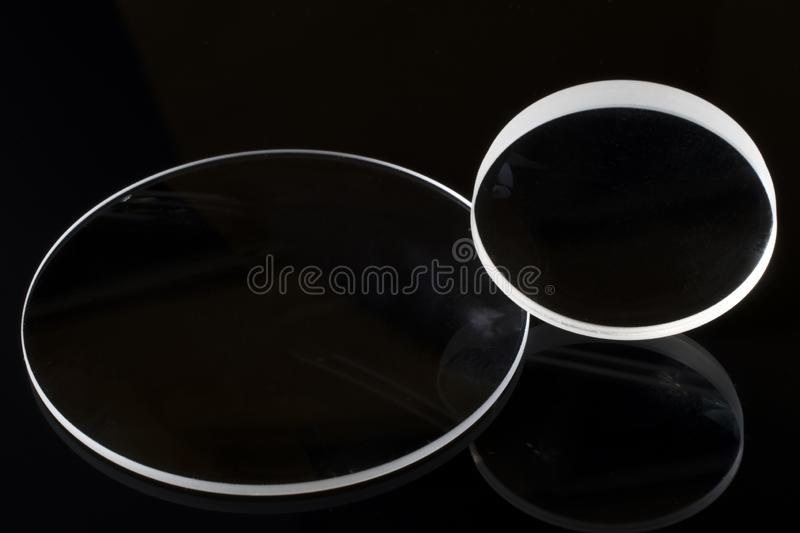 Optical lenses of photographic lens with black background royalty free stock photo
