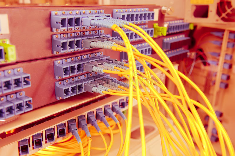 Optical network cables and servers. Fiber optical network cable in servers stock photo