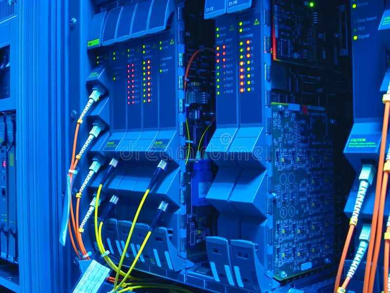 Optical network cables and servers. Fiber optical network cable in servers royalty free stock photography