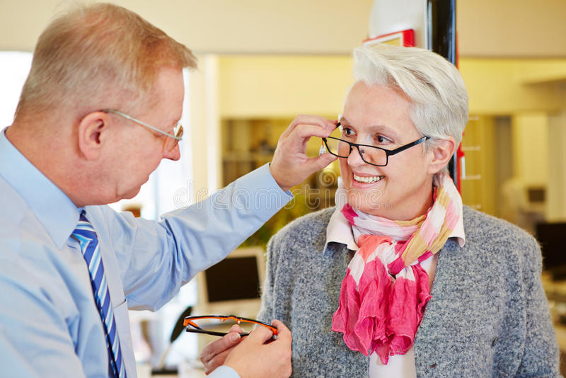 Optician offering consultation stock images