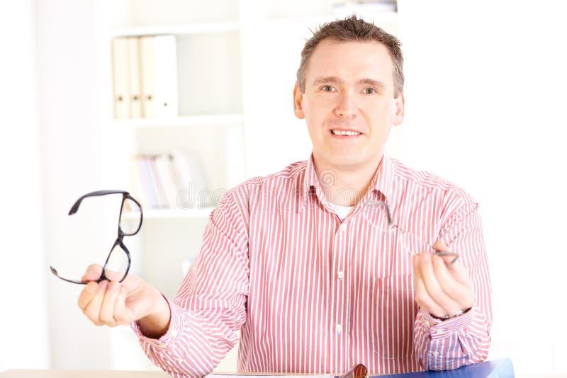 Optician Presenting Glasses Stock Image