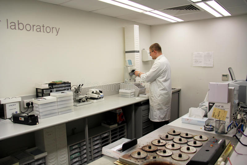 Optician's laboratory. England, Kent, Orpington. A technician at work in a Opticians laboratory in Orpington, Kent, United kingdom. Image taken Circa July stock image