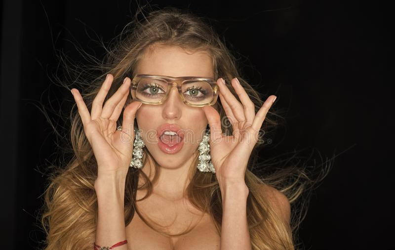 Optics store concept. Girl short sightedness needs modern eyeglasses. Woman with surprised face wears ugly eyeglasses stock image
