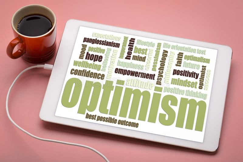 Optimism word cloud on tablet. Optimism word cloud on a digital tablet with a cup of coffee stock photo