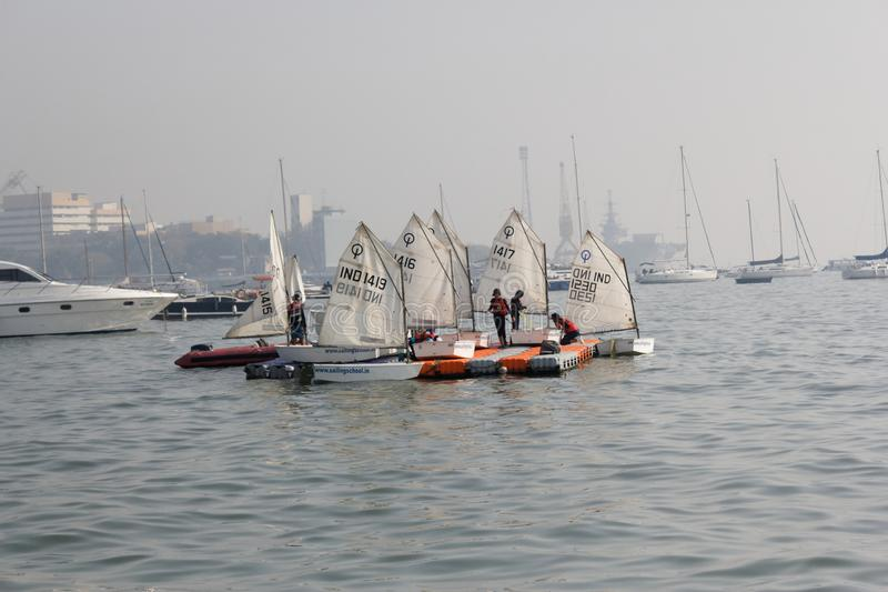 Children Sailing School, Optimist Dinghy Sail boat. The Optimist Dinghy, also known as the 'opti' or `bathtub`, is a small, single-handed sailing stock images