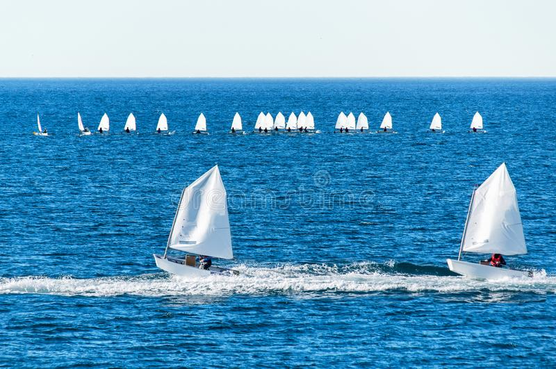 Optimist sailboat during a training. Session in the sea royalty free stock photos