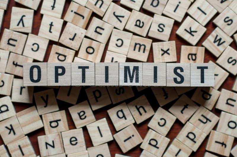 OPTIMIST word concept. On cubes royalty free stock photos