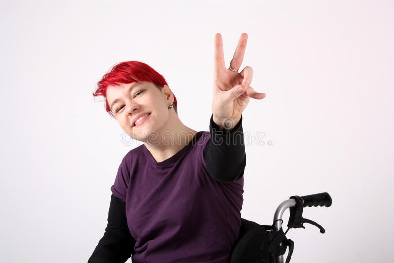 Optimistic Girl in wheelchair stock photos