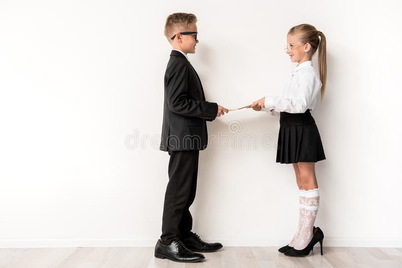 Optimistic kids are acting as business people stock images