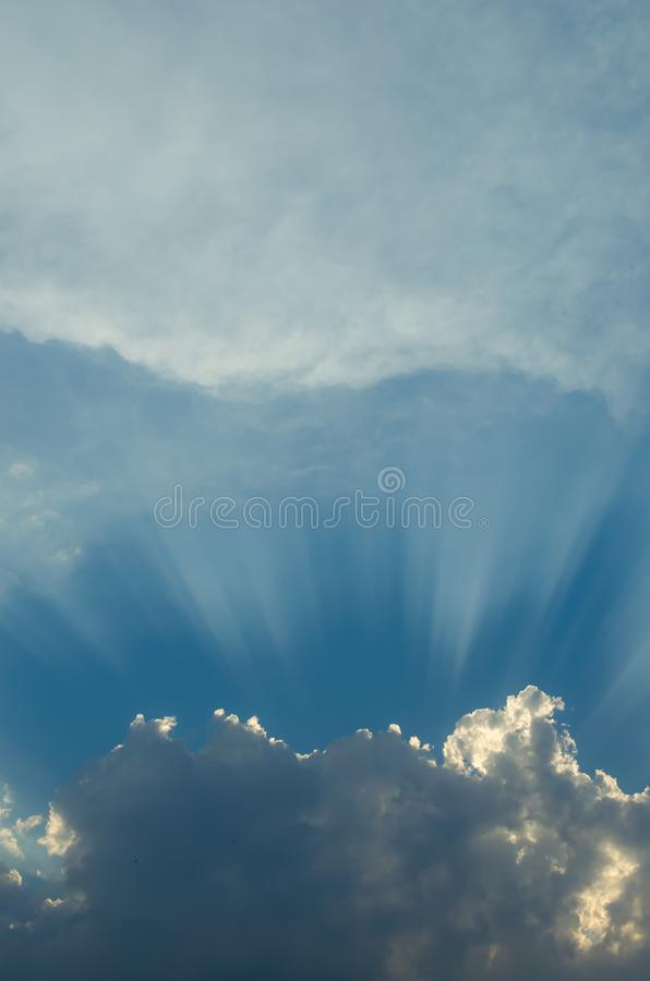 Optimistic sunset rays behind the clouds. Glow in the sky. Symbol of light. Beautiful scene of nature stock photo