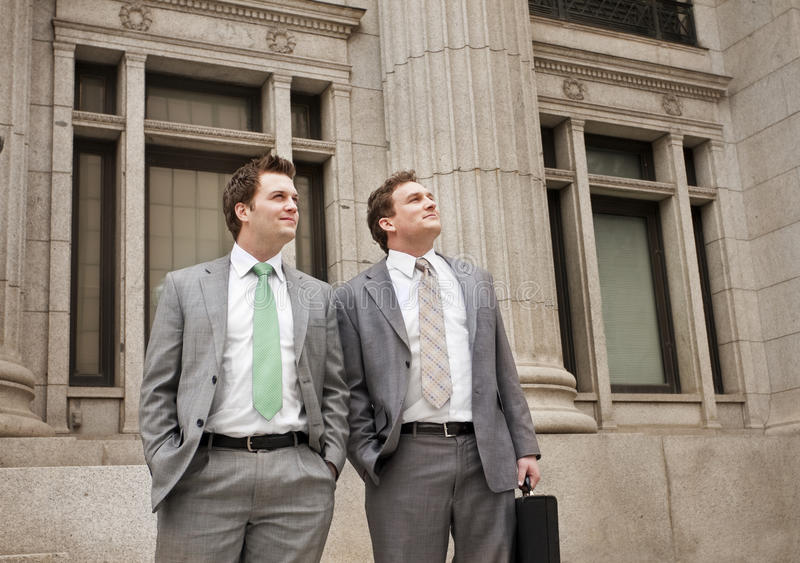 Optimistic Young Businessmen. Two young businessmen looking towards a bright future. Looking ahead to financial success royalty free stock photo