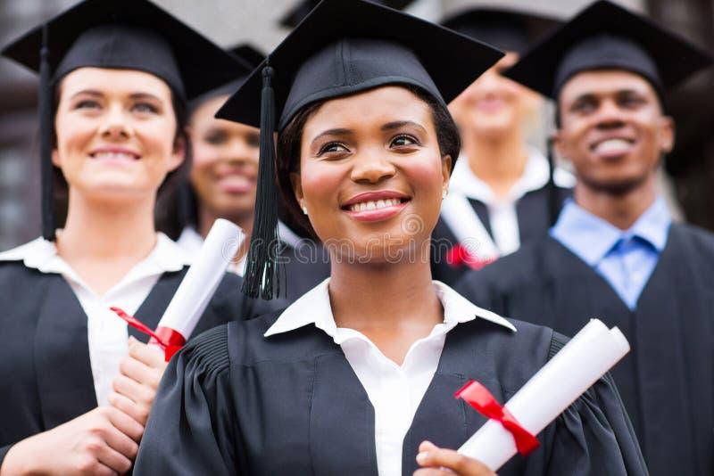 Optimistische universitaire gediplomeerden royalty-vrije stock foto