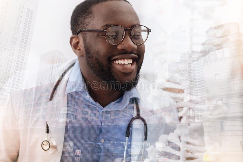 Optimistisk kompetent doktor som i huvudsak ler royaltyfri bild
