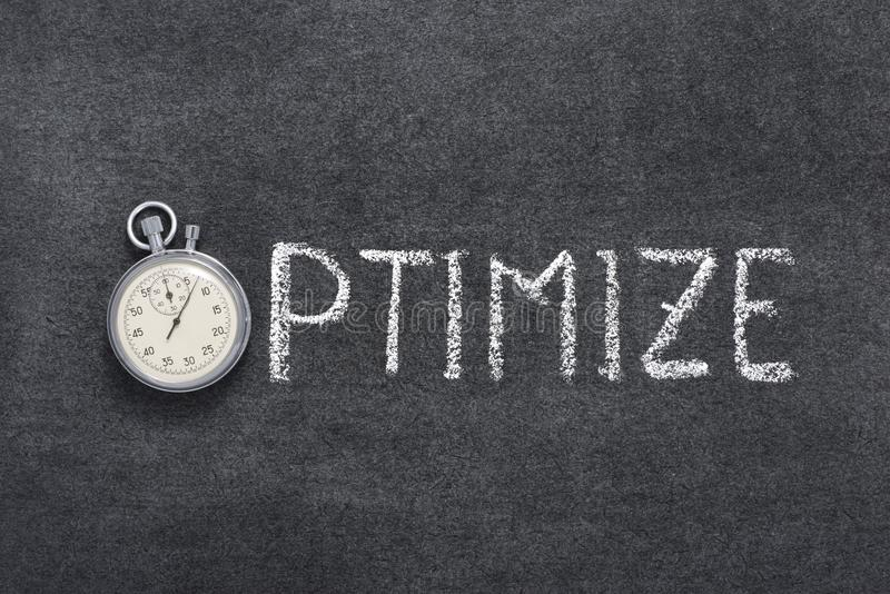 Optimize. Word concept handwritten on chalkboard with vintage precise stopwatch used instead of O stock images
