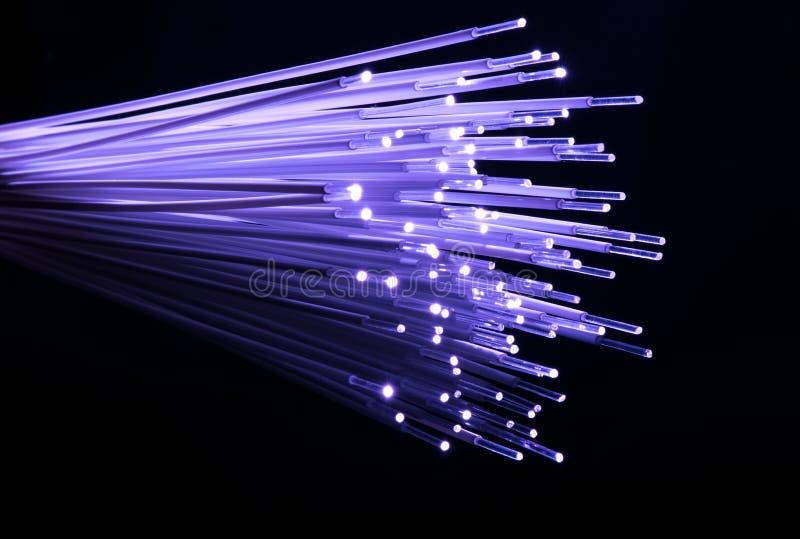 Download Optisk bakgrund för fiber fotografering för bildbyråer. Bild av glöda - 76702507